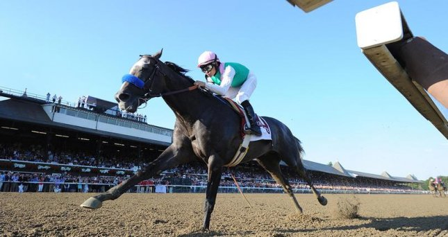 Arrogate is all alone at the end of Saturday's Travers at Saratoga, destroying some of the best U.S 3-year-olds in track-record time. (NYRA Photo)