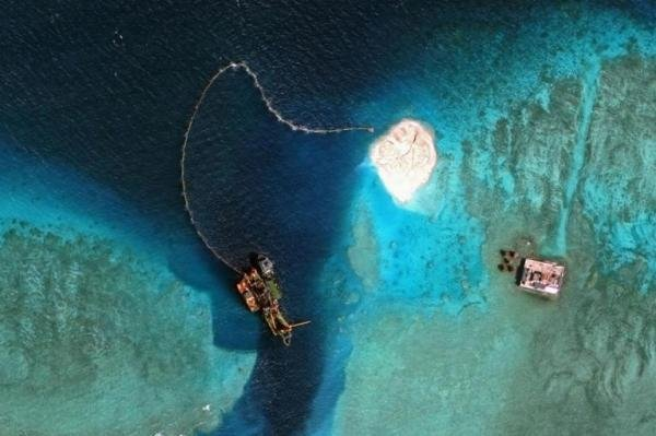 A satellite image from September of Mischief Reef in the disputed Spratly Islands showed China had made signifcant progress reclaiming land on coral reefs. Despite rising tensions, Beijing invited U.S. Navy officers to board its sole aircraft carrier on Monday. File Photo courtesy of CSIS Asia Maritime Transparency Initiative / DigitalGlobe