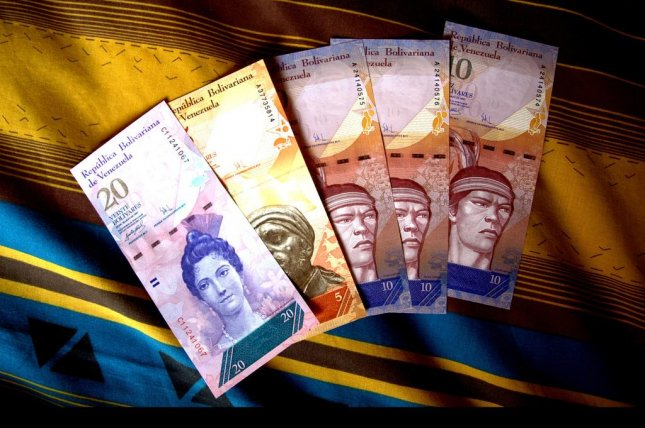 Amid soaring inflation, Venezuela's bolivar currency, pictured here, has been devalued to unprecedented levels. The Central Bank of Venezuela said it will issue new higher-value currency starting Dec. 15 to aid consumers. The largest Venezuelan bolivar is the 100 note. The largest Venezuelan bolivar to be issued under the bank's new policy will be a 20,000 note. File Photo by Jorge Andrés Paparoni Bruzual/Flickr