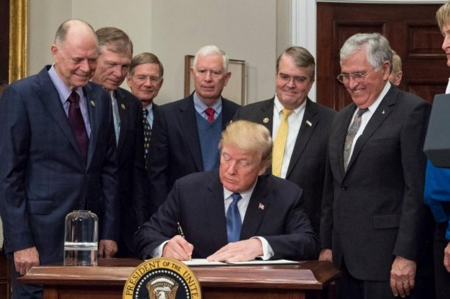 President Donald J. Trump, C, signs Space Policy Directive 1, a change in national space policy, on December 11, 2017. The House Armed Services Committee approved a new military branch for space on Thursday. File photo by  Aubrey Gemignani/NASA/UPI