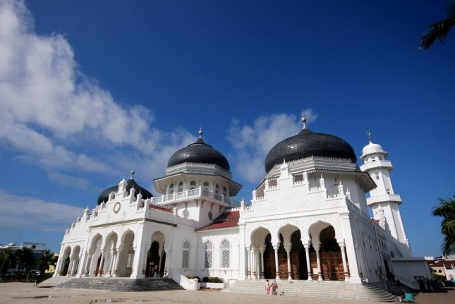The Baiturrahman Grand Mosque in Banda Aceh, Indonesia. The province of Aceh is primarily Muslim. Banda Aceh has imposed an 11 p.m. curfew on women who work in sports and entertainment locations.File Photo Tamil Selvam/Shutterstock
