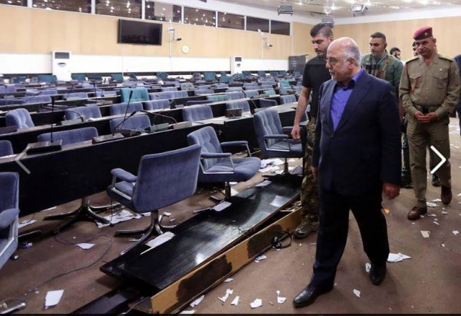 Iraqi Prime Minister Haider al-Abadi inspects damage done in his country's capital Saturday when protesters stormed in demonstrating against Parliament's slow pace in switching up Cabinet members. Photo from Haider al-Abadi/Facebook