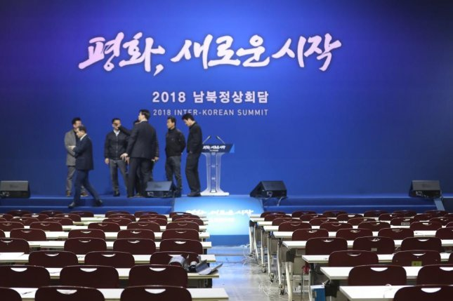 A rehearsal is under way on Tuesday at the press center in Goyang City, South Korea, ahead of Friday's inter-Korea summit. The slogan in Korean reads, Peace, A New Start. Photo by Yonhap
