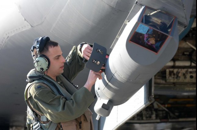 A B-1 offensive systems officer loads software into a Lockheed Martin Sniper Advanced Targeting Pod on a B-1B Lancer. The long-range targeting system provides aircrews with positive target identification, autonomous tracking coordinate generation and precise weapons guidance from extended standoff ranges supporting air to ground operations. U.S. Air Force photo by Airman 1st Class Rebecca Imwalle
