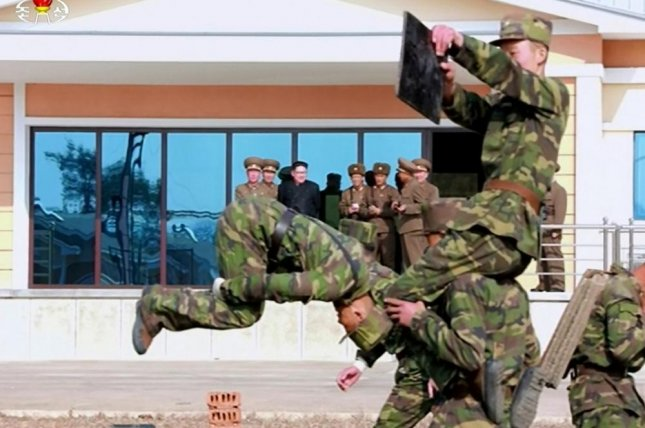 Kim Jong Un watches North Korean soldiers of Korean People's Army Unit 525 train during a recent visit. Photo by KCTV