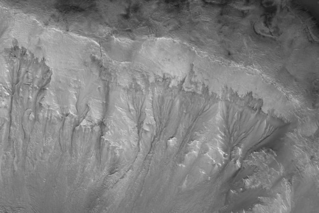 New research suggest deep groundwater on Mars could explain the phenomenon known as recurrent slope linae, the stream-like markings photographers here on the wall of the Palikir Crater. Photo by NASA/JPL/University of Arizona