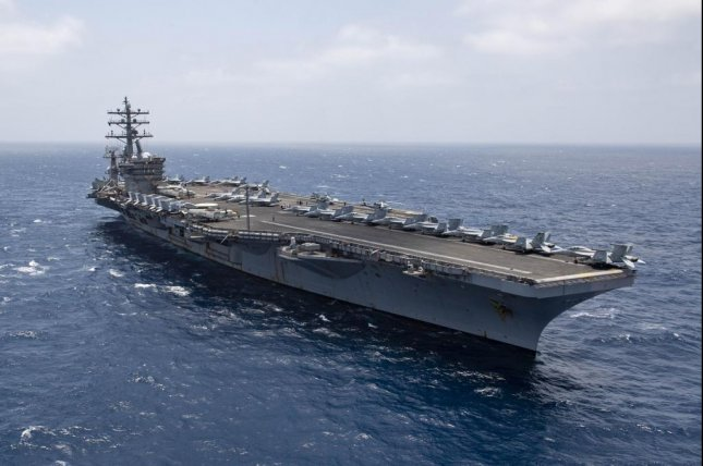 The aircraft carrier USS Dwight D. Eisenhower transits the Arabian Sea in this June 12 photo. Ike is deployed to the U.S. 5th Fleet area of operations in support of naval operations to ensure maritime stability and security in the Central Region, connecting the Mediterranean Sea and Pacific Ocean through the western Indian Ocean and three critical chokepoints to the free flow of global commerce. Photo by Aaron Bewkes/U.S. Navy