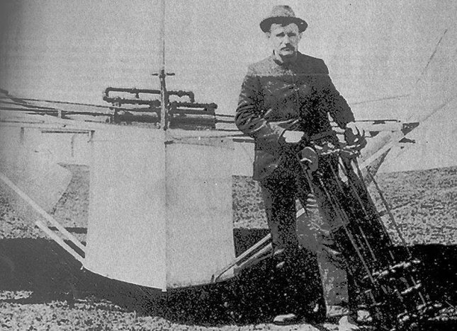 Gustave Whitehead holding a motor in front of his 1901 monoplane the Condor, or Number 21. (PD/US)