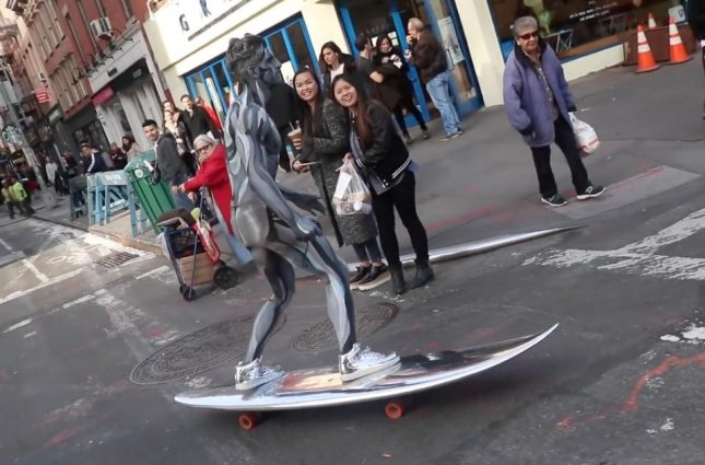 Jesse Wellens of YouTube channel PrankvsPrank rode through the streets of New York City dressed in an elaborate Silver Surfer costume. The costume featured comic book-style paint by make-up artist Alexys Fleming, metallic silver sneakers and a motorized surfboard.  Screen capture/PrankvsPrank/YouTube