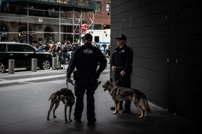 Police officers with dogs stand at the ready in New York City on Wednesday. Photo courtesy of NYC Mayor's Office/Twitter