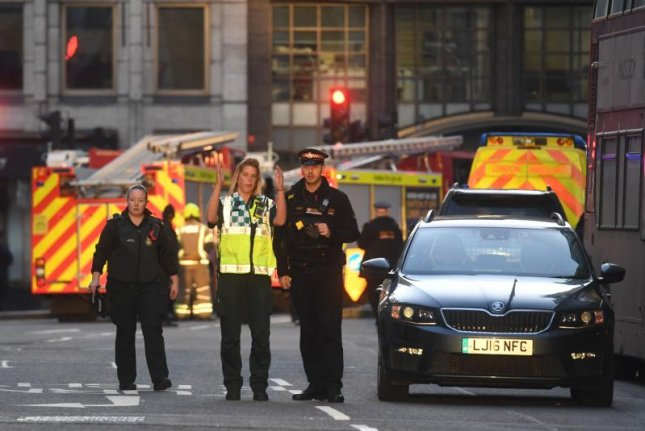 Emergency services are shown close to the scene at London Bridge on Friday, where police shot and killed a suspect after a stabbing incident. Photo by Facundo Arrizabalaga/EPA-EFE