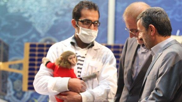 Iranian President Mahmoud Ahmadinejad meets with the monkey Iran claimed they sent into space. (UPI/NAMNA)