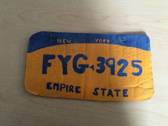 A New York Woman was pulled over for driving with a counterfeit license plate. The handwritten cardboard plate was designed to look like a New York license plate. She was charged with possession of a forged instrument and held on $400 bail. Photo by Erie County Sheriff's Office/Facebook