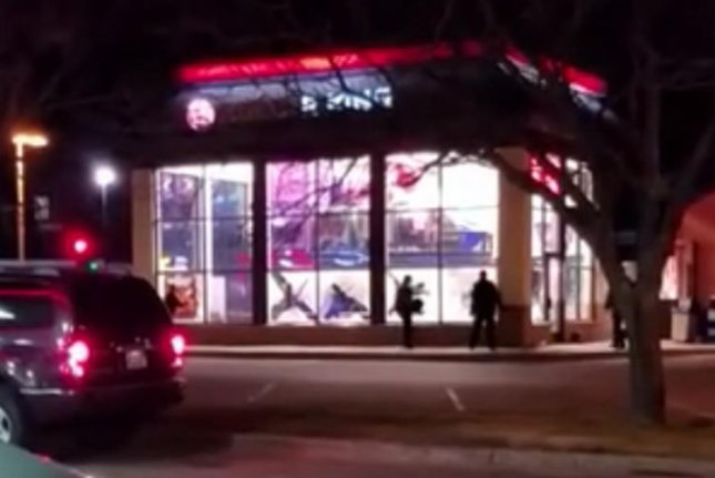 Workers at a Coon Rapids, Minn., Burger King smash out the windows of the eatery after a hoax caller claimed there was a gas leak in the building. Screenshot: Twacked420/YouTube