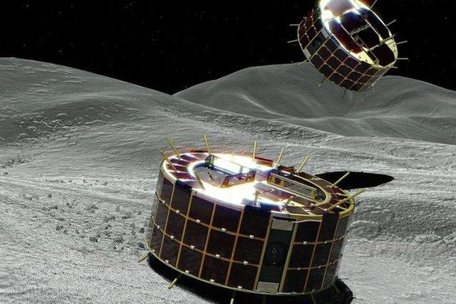 Space robots sent hurtling toward asteroid