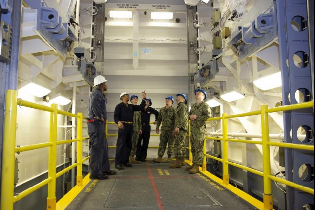 Chief Machinist's Mate Franklin Pollydore (second from left) goes over safety procedures for the Upper Stage 1 advanced weapons elevator with sailors from USS Gerald R. Ford's weapons department on January 16. Photo by Mass Communication Spec. 1st Class Jeff Troutman/U.S. Navy