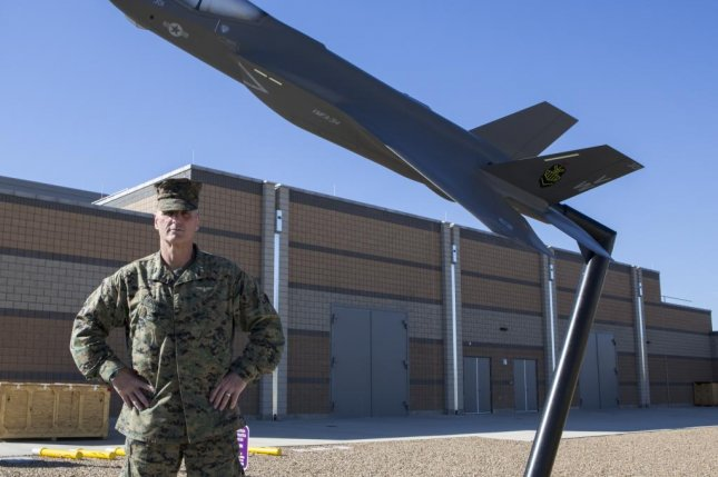 A U.S. Marine stands in front of the new F-35 flight simulator on Marine Corps Air Station Miramar, Calif., on Jan. 21. Photo byLevi Voss/U.S. Marine Corps