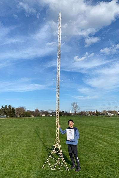 Eric Klabel, 12, of Naperville, Ill., broke a Guinness World Record when he used popsicle sticks to build a tower measuring 20.2 feet tall. Photo courtesy of Guinness World Records