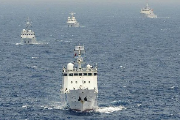 Chinese vessels sailing near the disputed Senkaku Islands in 2013. Chinese vessels equipped with heavy machine guns were seen in February near Japan's territory, according to local press. Photo by Times Asi/Flickr