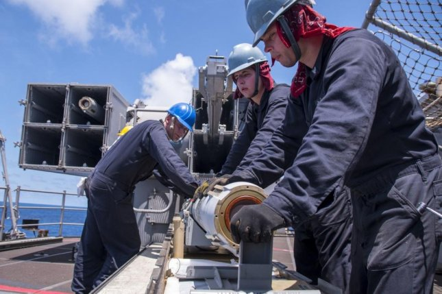 Fire Controlmen assigned to the amphibious assault ship USS Bonhomme Richard (LHD 6) unload a RIM-7 Sea Sparrow missile from the ship's aft NATO Sea Sparrow launcher. Photo by Mass Communication Specialist 2nd Class Jeanette Mullinax/U.S. Navy