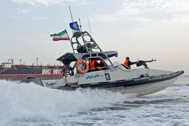 An Iranian Revolutionary Guard jet boat sails around a seized tanker in Bandar Abbas in southern Iran last month. Iran announced Sunday that it will hold joint military operations with Russia in the Persian Gulf. Photo by Hasan Shirvani/EPA-EFE