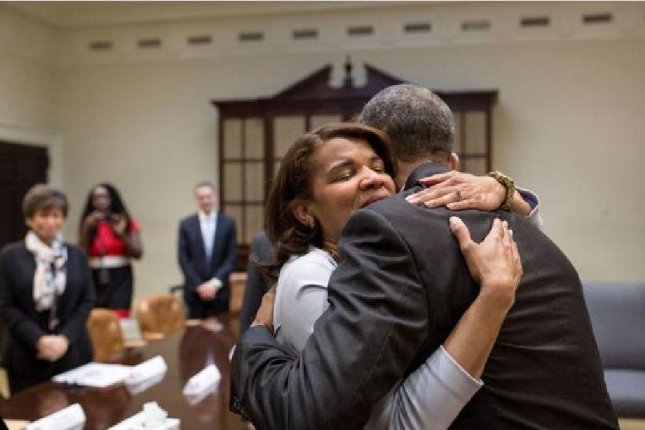 President Barack Obama hugs Kemba Smith during a meeting at the White House in March with formerly incarcerated individuals who have received commutations through the president's 2014 second chance initiative. On Wednesday, Obama granted clemency applications for 214 additional prisoners. Photo by Pete Souza/White House