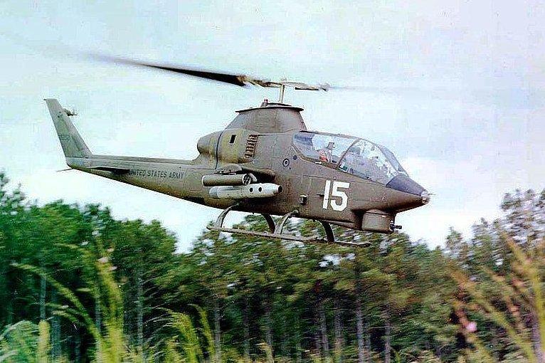 An AH-1 in flight in Asia. (U.S. Army photo)