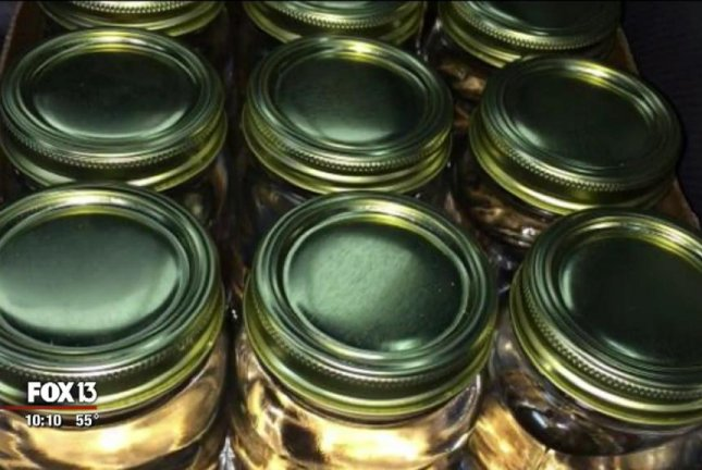 Illegal moonshine was offered for sale on a Facebook page. WTVT-TV video screenshot