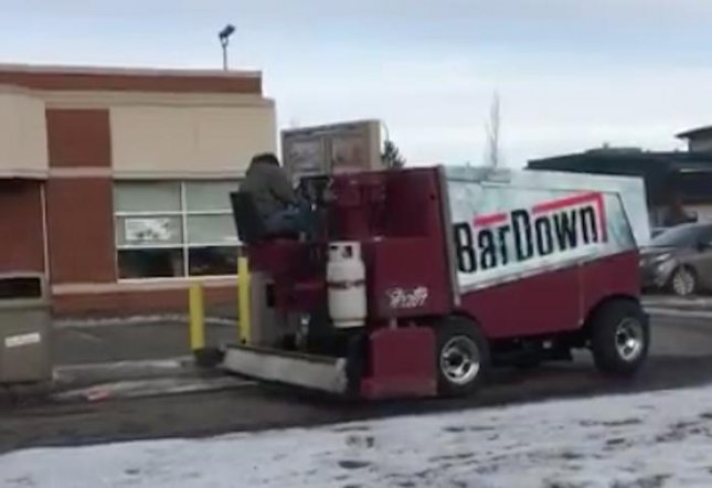 A Canadian man rode his Zamboni machine through a Tim Hortons drive-thru to get a cup of hot chocolate. Jesse Myshak said the customer in front of him was so amused they paid for his drink and the employees said the stunt was the most Canadian thing they've ever seen. Screen capture/Jesse Myshak/Twitter