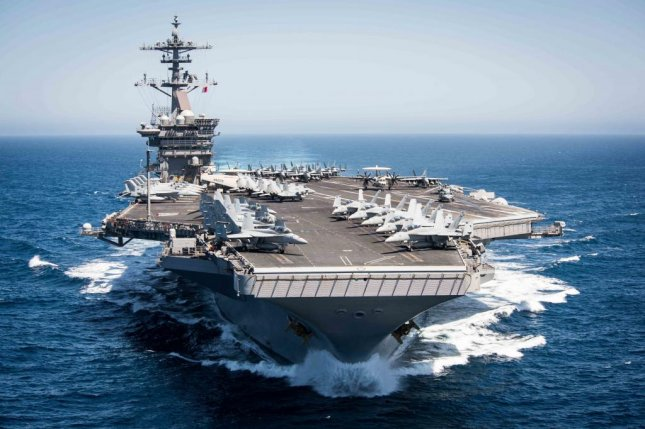 The Nimitz-class aircraft carrier USS Theodore Roosevelt, and its strike group, departed on August 1 for Composite Training Unit Exercise before deployment scheduled for later this year. U.S. Navy photo