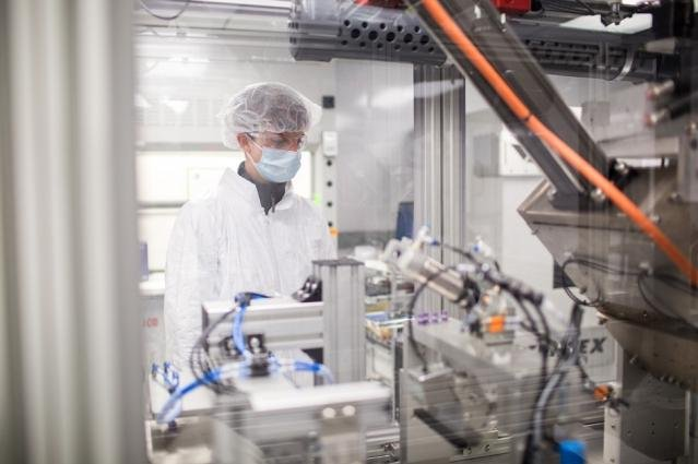 A scientist oversees the production process of new semisolid battery prototypes. Photo by MIT