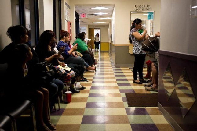 Patients wait to be seen at the People's Community Clinic in Austin, Texas, which provides state-subsidized health services to low-income families and individuals. Photo by Callie Richmond for The Texas Tribune