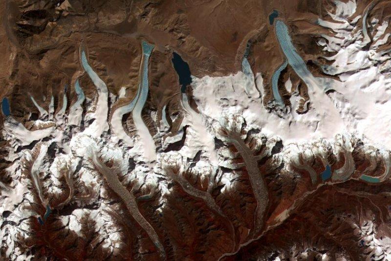 A satellite image shows several Himalayan glacial lakes in Bhutan. Photo by NASA