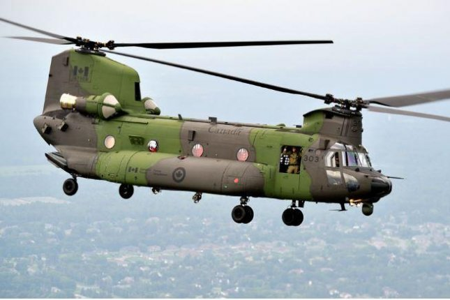 A CH-147F Chinook helicopter of the Royal Canadian Air Force travels over Mali. The Canadian Armed Forces announced the conclusion of it year-long mission in Mali on Sunday. Photo courtesy of Royal Canadian Air Force