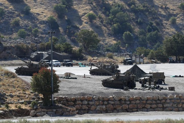 Israeli soldiers with their artillery unit deployed at the Israeli-Syrian border, in the Golan Heights in 2019. Israel said Monday it destroyed a vehicle near the border because of a sniper threat. Photo by Atef Safadi/EPA-EFE