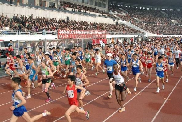 Runners at the 2014 Pyongyang Marathon from 27 countries ran alongside North Korean athletes in a 26-mile race that started and finished in Kim Il Sung Stadium. The North Korean organizers have told tour operators there will be an indefinite ban on foreign runners this year due to Ebola concerns. Photo by Korean Central News Agency via Yonhap