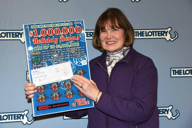 Jane Hoyt of Lynn, Mass., won her second $1 million prize in seven months, receiving two separate cash payments of $650,000. Photo courtesy of Massachusetts Lottery/Facebook