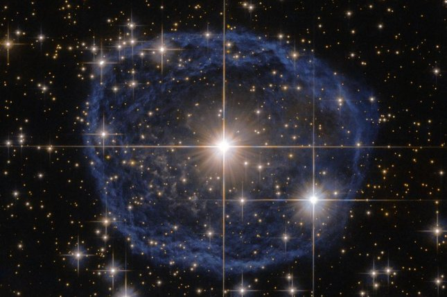 A new Hubble image shows a Wolf–Rayet star, known as WR 31a, surrounded by a blue bubble of interstellar gas and dust. Photo by ESA/NASA