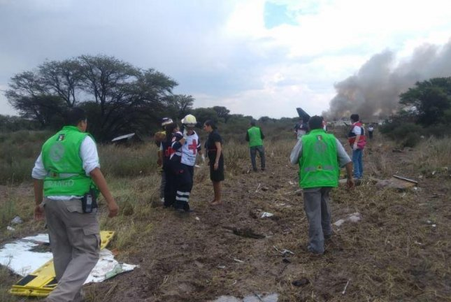 Emergency crews attend to passengers amid the wreckage of an Aeromexico jetliner that crashed just after takeoff Tuesday from General Guadalupe Victoria International Airport in Durango, Mexico. Photo courtesy Proteccion Civil DGO/Twitter