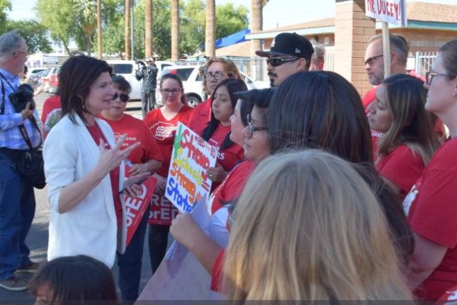 Lily Eskelsen Garcia (L), president of the National Education Association, speaks to Arizona teachers Thursday as they prepare to march to the state capitol in Phoenix to rally for more funding. Photo courtesy Lily Eskelsen Garcia/Twitter