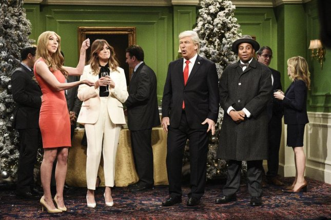 """L-R Heidi Gardner as Hernia Trump, Cecily Strong as Melania Trump, Alec Baldwin as Donald Trump, and Kenan Thompson as Clarence the angel during the """"It's a Wonderful Trump"""" parody on Saturday Night Live. Photo by Will Heath/NBC"""