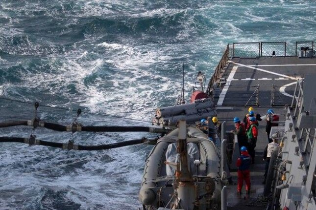 A Russian fighter jet this weekend took a low pass near the USS Donald Cook, the crew of which is pictured during refueling from the oiler USNS Laramie on Friday. Photo by Specialist 3rd Class Will Hardy/U.S. Navy