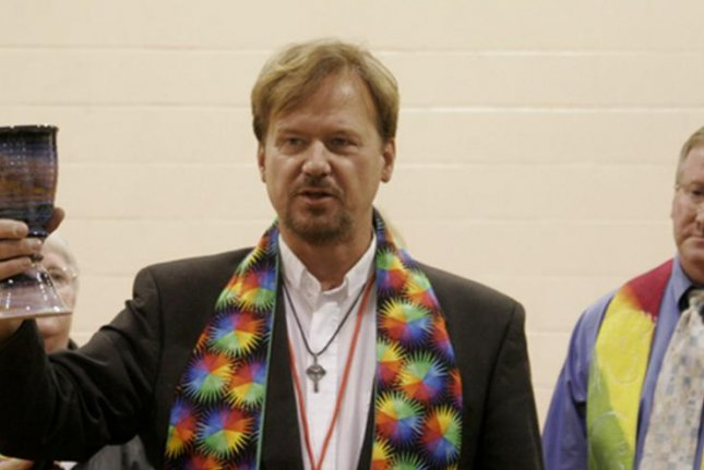 United Methodist Rev. Frank Schaefer serves communion to his supporters at the end of his two-day church trial. (Kathy L. Gilbert/United Methodist News Service.)