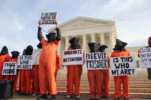 Close Guantanamo Bay Coalition protesters stand Wednesday in front on the U.S. Supreme Court urging President Barack Obama to close the detention facility. Photo by Shahzeb Hashem/Medill News Service
