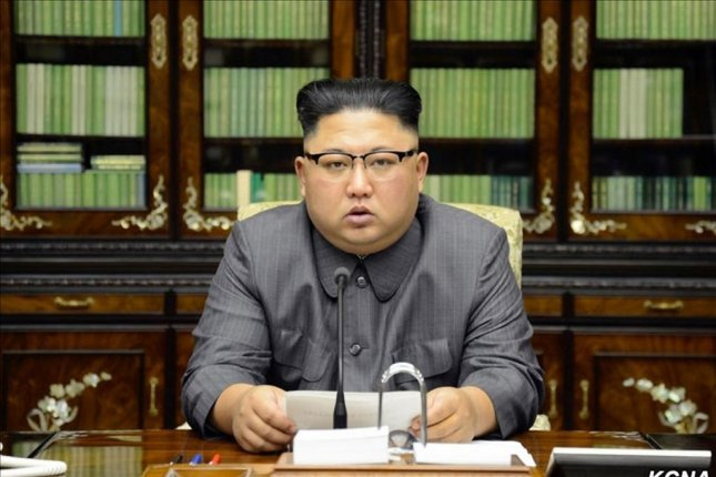 North Korean leader Kim Jong Un reads a statement released Friday, threatening to take the highest level of hardline countermeasure in history against U.S. President Donald Trump. Photo by Yonhap