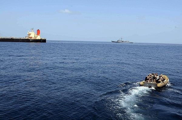 A rigid hull inflatable boat from USS Bulkeley (DDG 84 approaches Japanese-owned commercial oil tanker M/V Guanabara with Turkish warship TCG Giresun of NATO's counter-piracy Task Force 508 in the background, courtesy of the U.S. Navy.