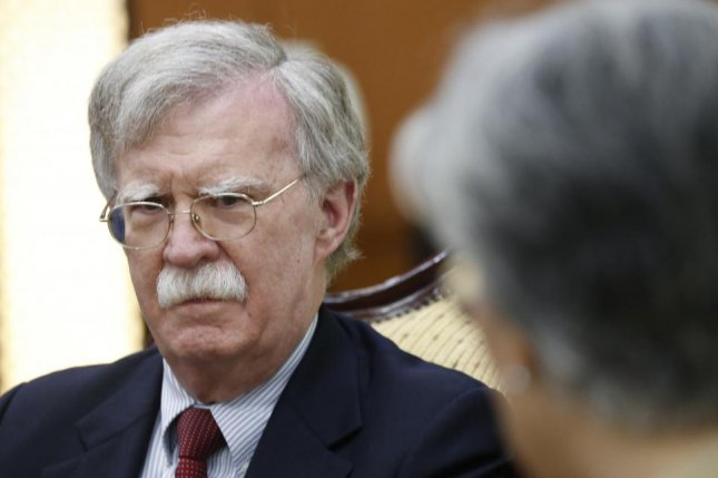 White House national security adviser John Bolton (L) listens to South Korean Foreign Minister Kang Kyung-wha (R) during their meeting at the foreign ministry building in Seoul, South Korea, on Wednesday. Photo by Kim Hee-chul/EPA-EFE/Pool