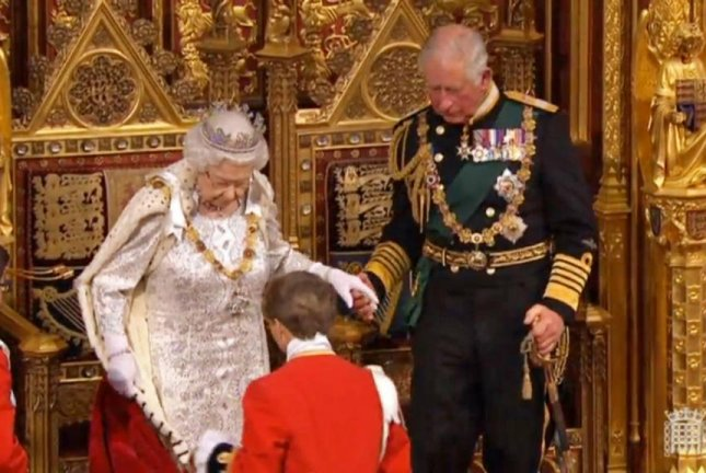 A handout video grab shows Britain's Queen Elizabeth II and Prince Charles taking their seats on the throne at the House of Lords in London Monday. Photo by Britain Parliamentary Recording Unit/EPA-EFE