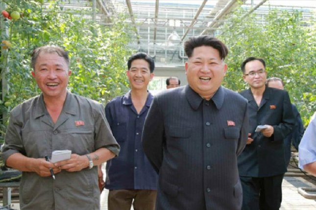 North Korean leader Kim Jong Un recently toured a vegetable research institute in Pyongyang. Kim is paranoid about food safety, according to a source. Photo by Rodong Sinmun/Yonhap