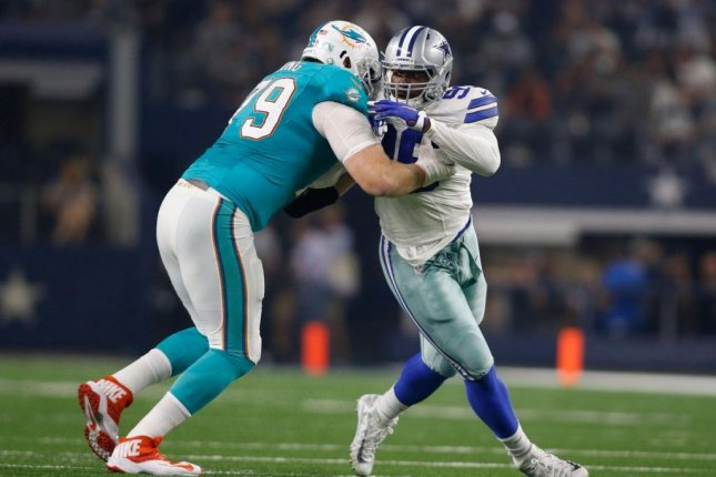The Miami Dolphins released offensive tackle Sam Young on Saturday, leaving guard Ted Larsen remaining on the 53-man roster. Photo courtesy of Miami Dolphins/Twitter